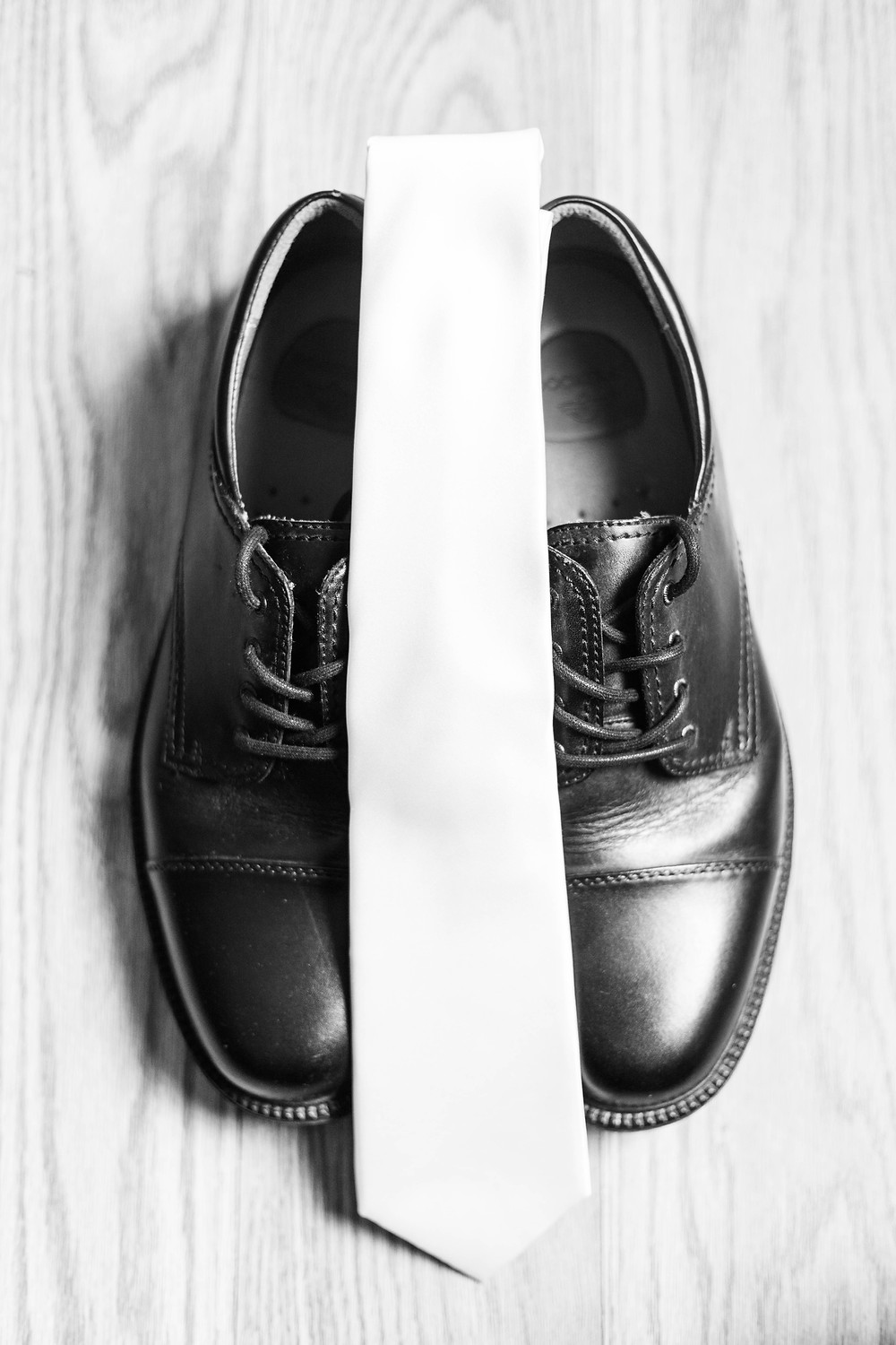 grooms black dress shoes and white tie detail photo Milledgeville Georgia