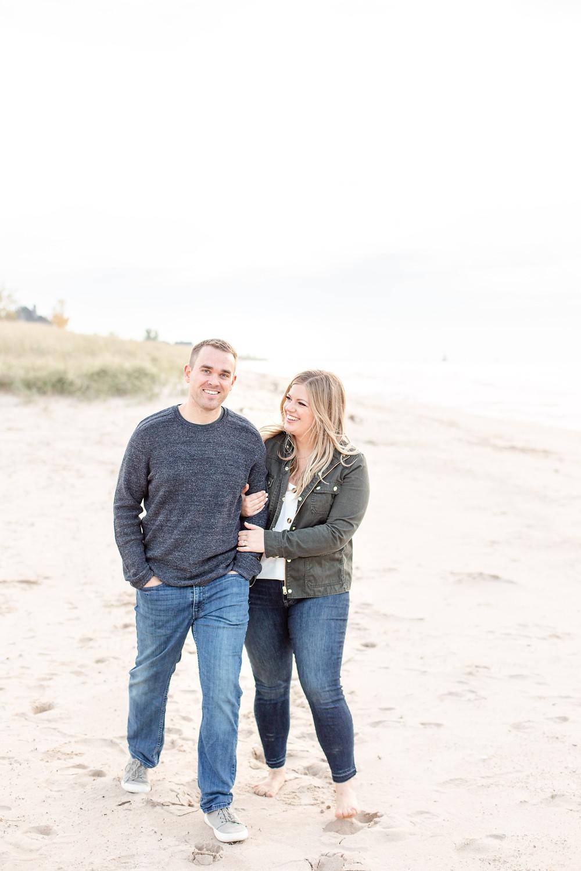 Engagement Photos Jean Klock Park Saint Joseph MI cute couple walking on beach
