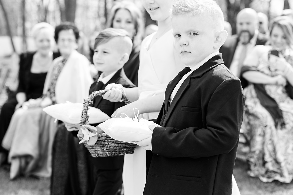 Josh and Andrea wedding photography husband and wife photographer team michigan Black Barn Wedding Venue rives junction spring flower girl ring bearer