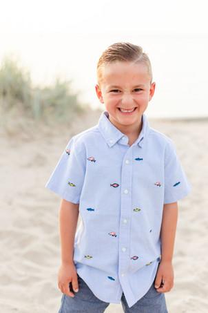 young boy smiling beach photo dune grass Lake Michigan