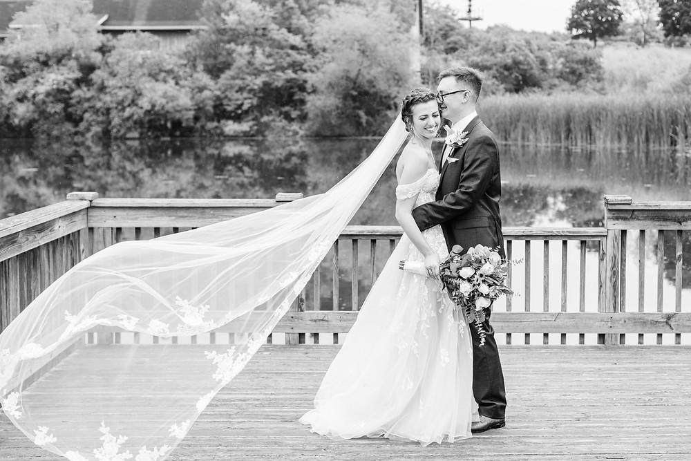 Bride and Groom veil shot Saint Patricks Park South Bend Indiana