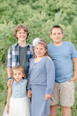 cute family coordinating outfit engel farms photo shoot kids standing smiling