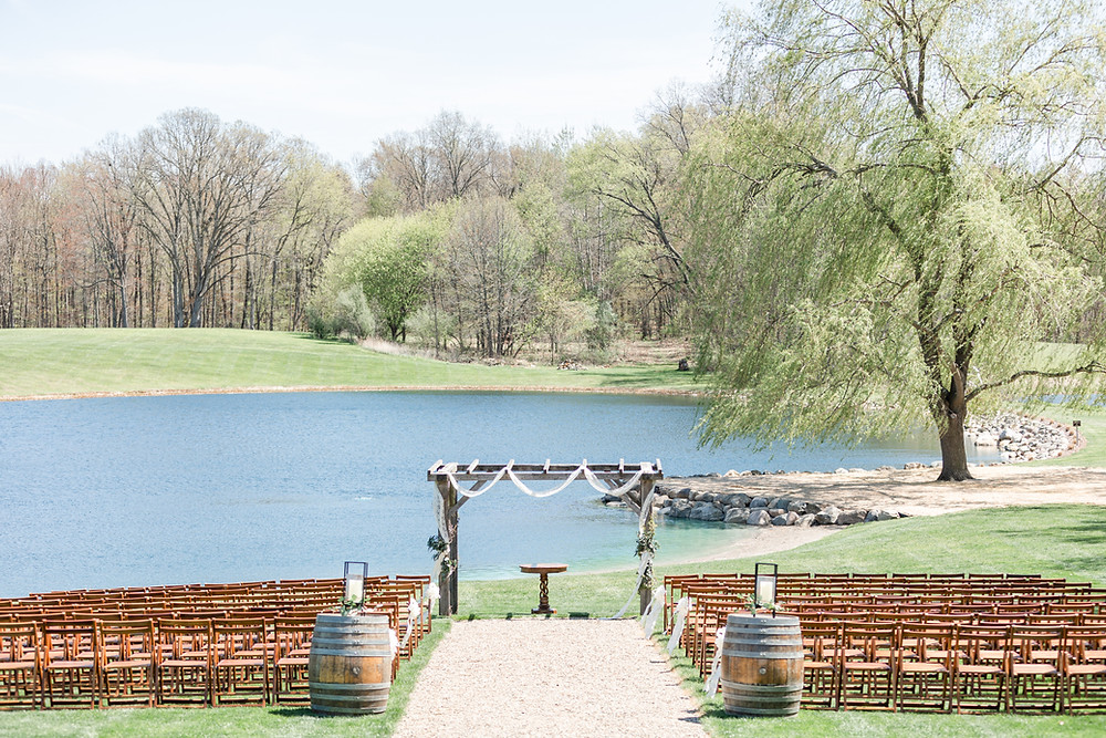 Josh and Andrea wedding photography husband and wife photographer team michigan Black Barn Wedding Venue rives junction spring