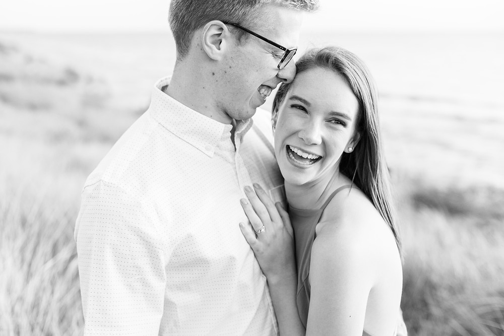Engagement Photos Tunnel Park Beach Holland Michigan Engaged Couple cuddling and laughing