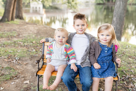 cute children sitting on bench niles