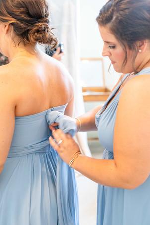 bridesmaids tying dress Kent Country Club Wedding Grand Rapids