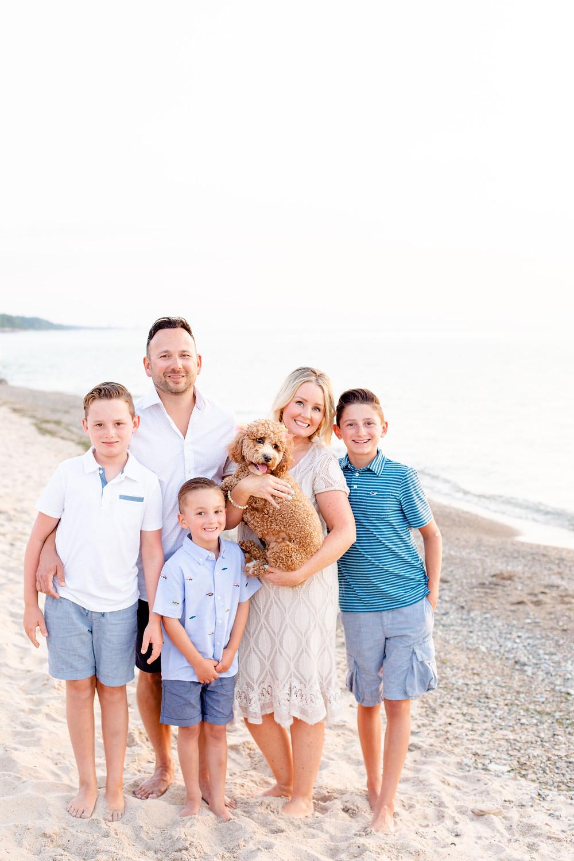 Family of 5 photos with dog standing beach Lake Michigan New Buffalo