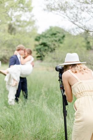 Kenzie Warner storytelling bride and groom smiling in field in the details byron center truer design