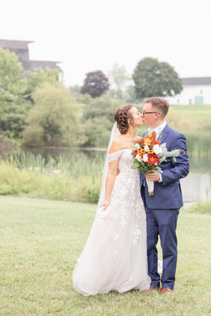 Bride and Groom kissing Bridal bouquet fall colors Saint Patricks Park South Bend Indiana