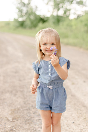 cute girl holding flower coordinating outfit engel farms photo shoot