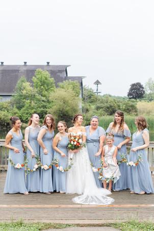 Bride and Bridesmaids laughing light blue dresses Saint Patricks Park South Bend Indiana