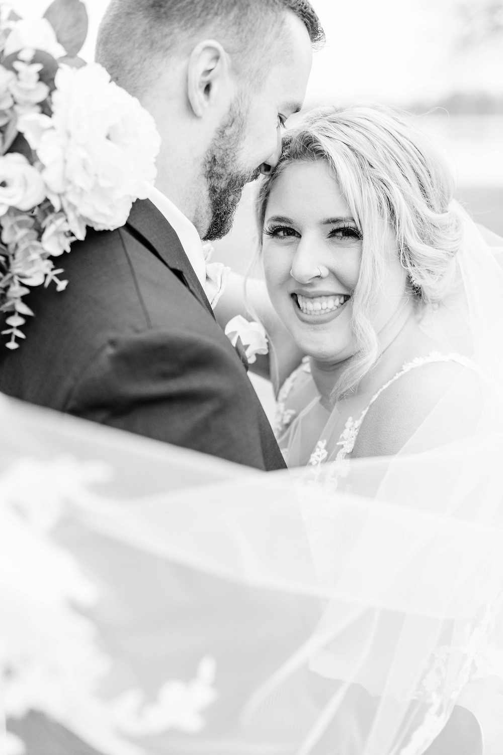 josh and Andrea photography husband and wife team michigan winter bride and groom smiling