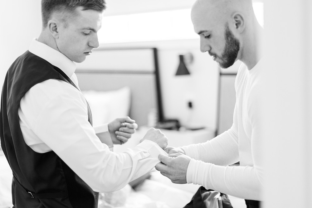 Josh and Andrea wedding photography husband and wife photographer team michigan venue Bay Pointe Woods shelbyville winter wedding groom getting ready
