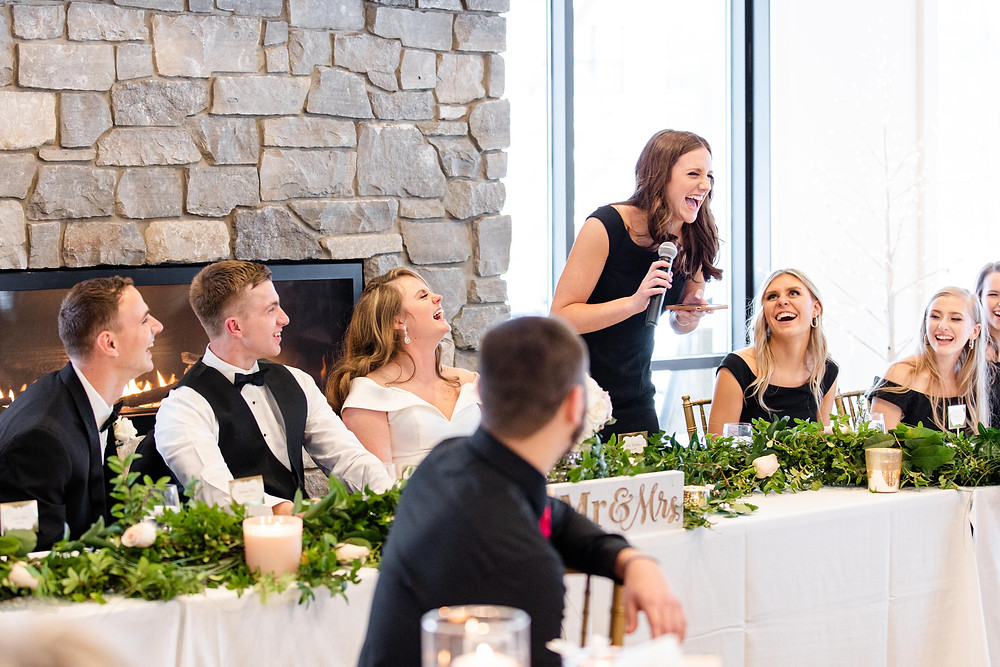 Josh and Andrea wedding photography husband and wife photographer team michigan venue Bay Pointe Woods shelbyville snow winter wedding reception family bridesmaid maid of honor black dress