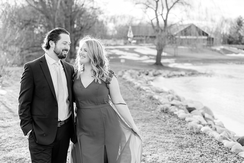 Josh and Andrea wedding photography husband and wife photographer team michigan Black Barn Wedding Venue Jackson winter engagement photo photos session fiance walking smiling