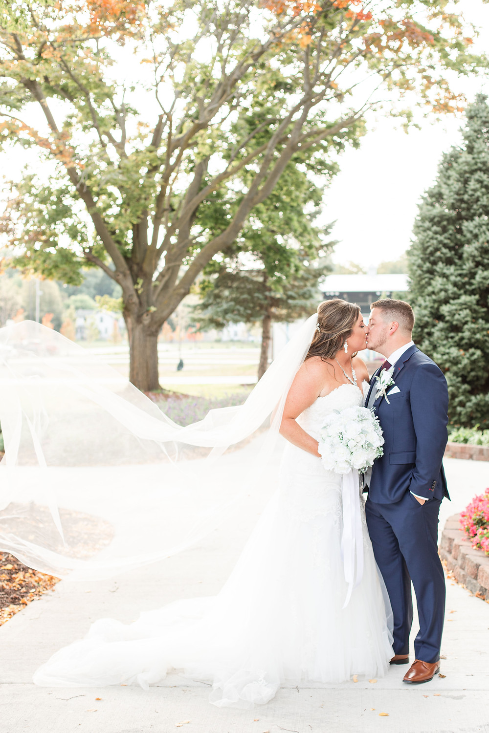 Bride and groom cute couple wedding American 1 event center Jackson michigan kissing