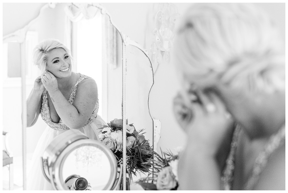 Josh and Andrea wedding photography husband and wife photographer team michigan pictures photo shoot Something Blueberry Wedding Barn farm spring bride getting ready