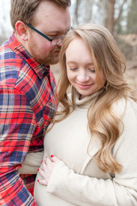 Maternity Photo Session with young woman and young man in a forest near South Haven Michigan