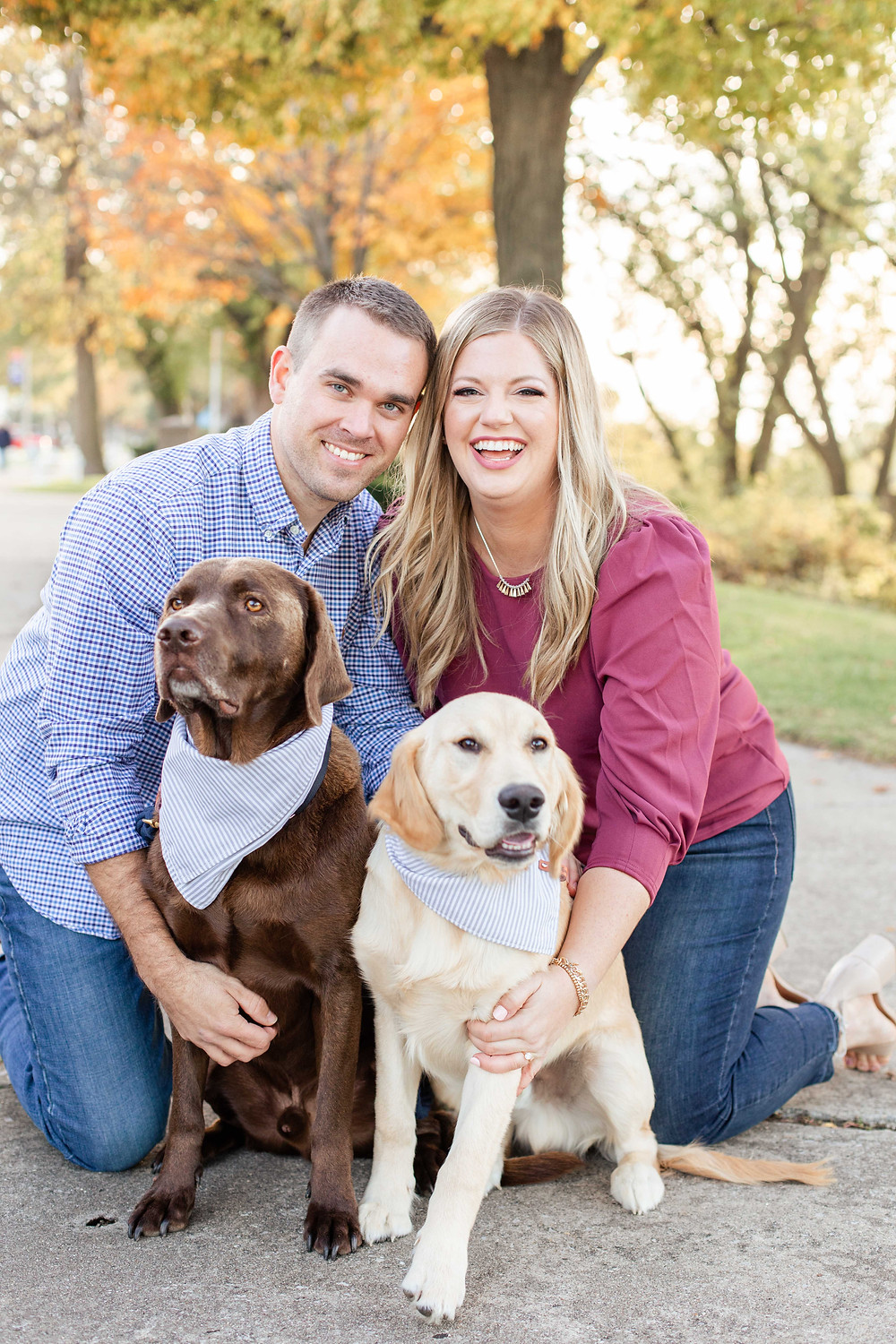 Engagement Photos Downtown Saint Joseph MI cute couple with two dogs