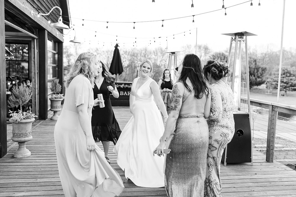 Josh and Andrea wedding photography husband and wife photographer team michigan Black Barn Wedding Venue rives junction spring reception bride and groom dancing