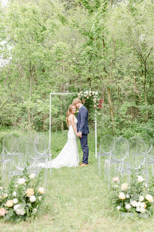 bride and groom ceremony in the details byron center truer design