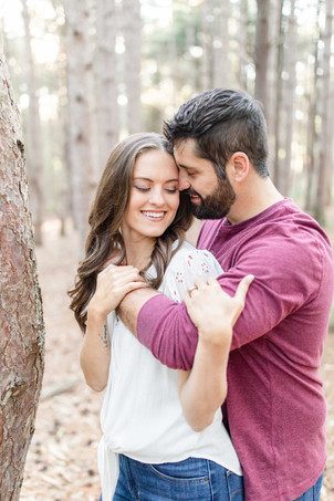 Cute couple smiling provin trails Grand Rapids engagement session