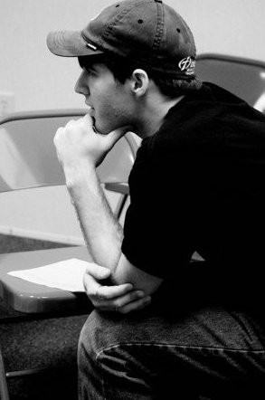 black and white young man thinking