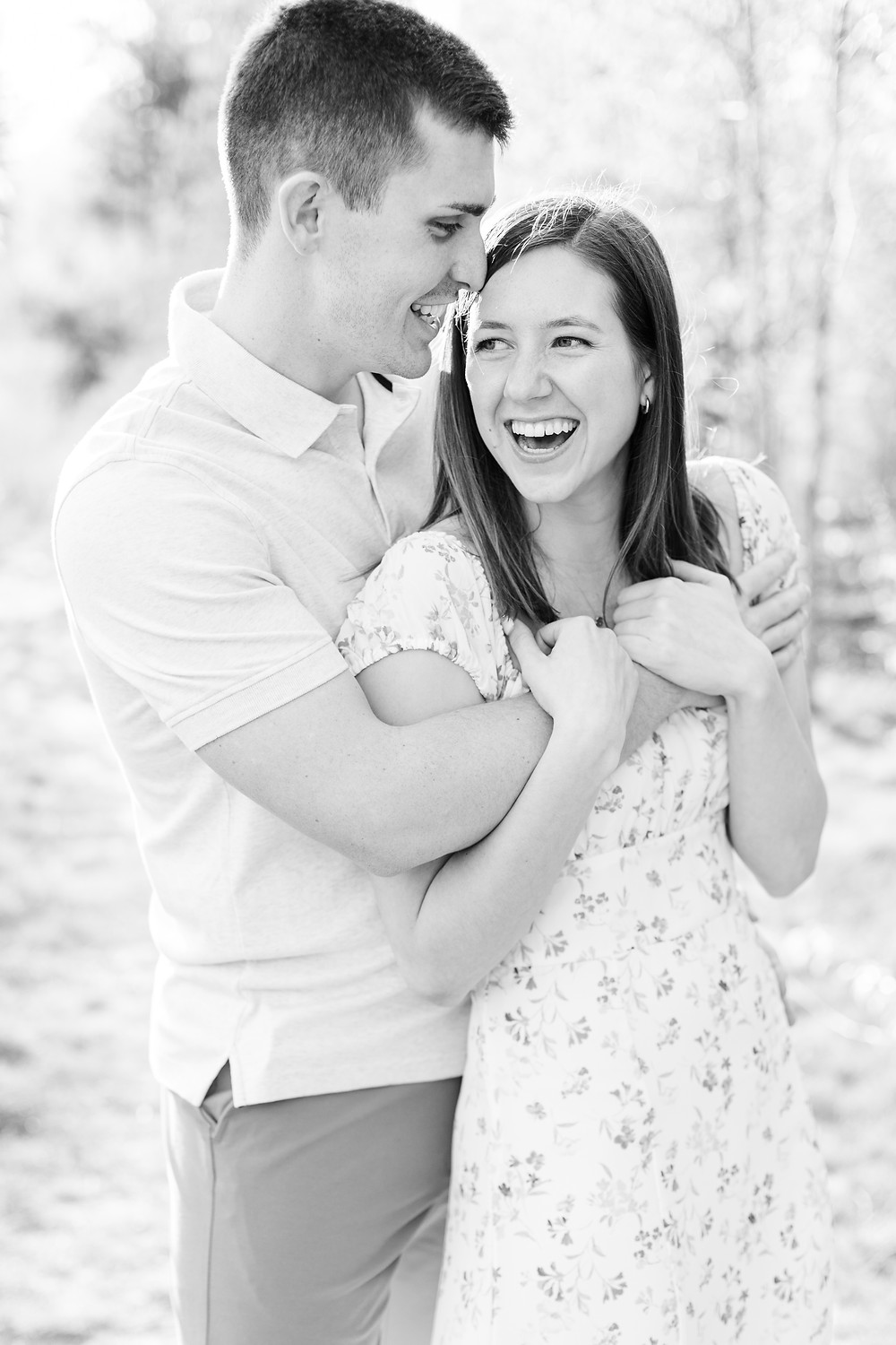 Josh and Andrea wedding photography husband and wife photographer team michigan engagement pictures session photo shoot fiance Riley Trails laughing smiling