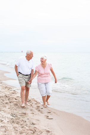 50 years of marriage older couple walking on the beach South Haven Michigan