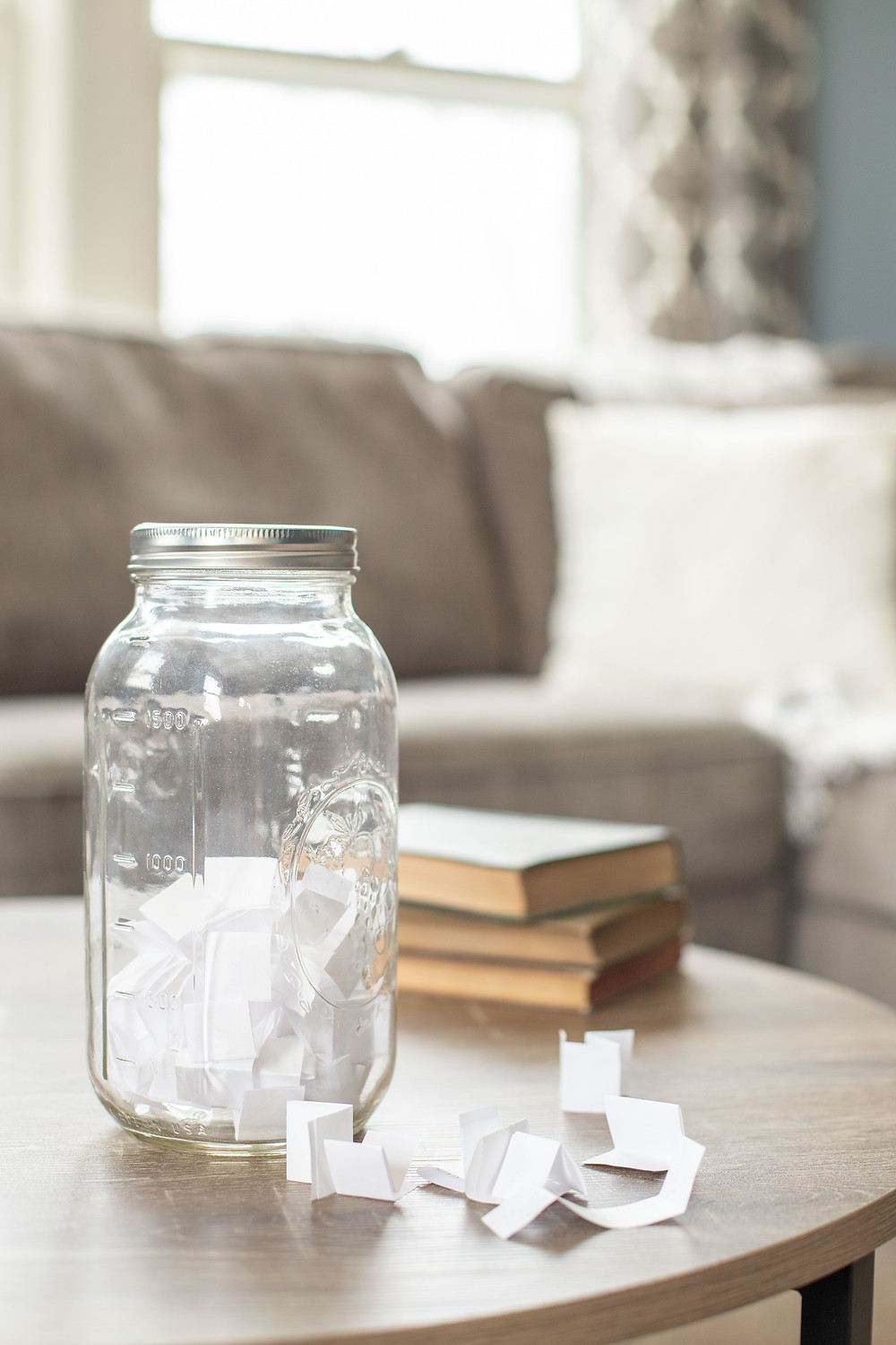 clear mason jar sitting paper strips