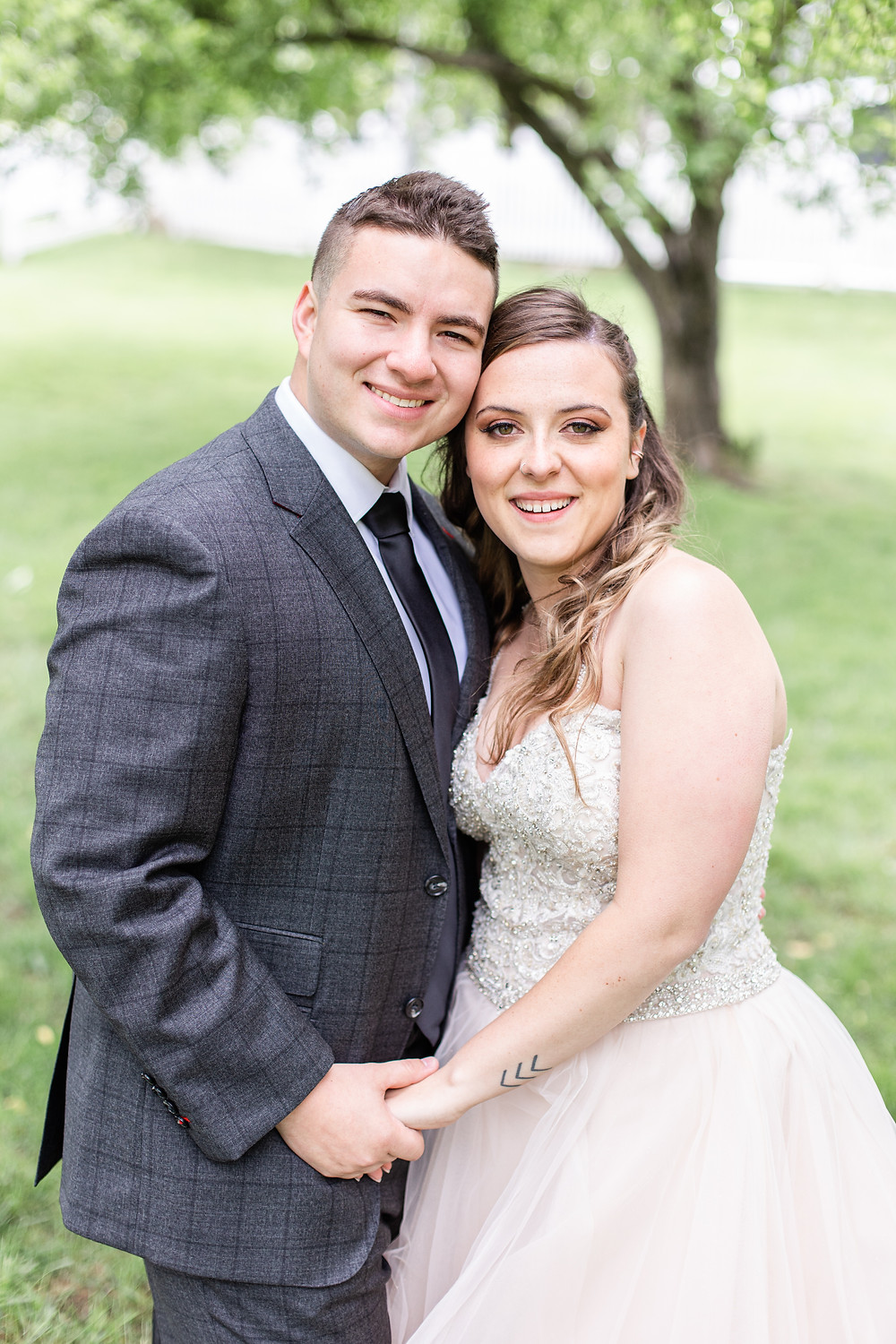 Josh and Andrea wedding photography husband and wife photographer team michigan pictures winter wedding hydrangea blu barn bride and groom first look apple orchard smiling
