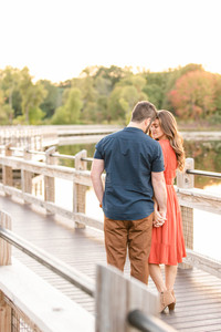 Cute couple standing on bridge provin trails Grand Rapids engagement session