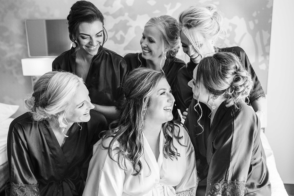 Bride and bridesmaids smiling laughing wedding American 1 event center Jackson michigan