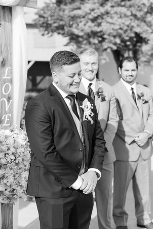 groom standing at the altar wedding American 1 event center Jackson michigan