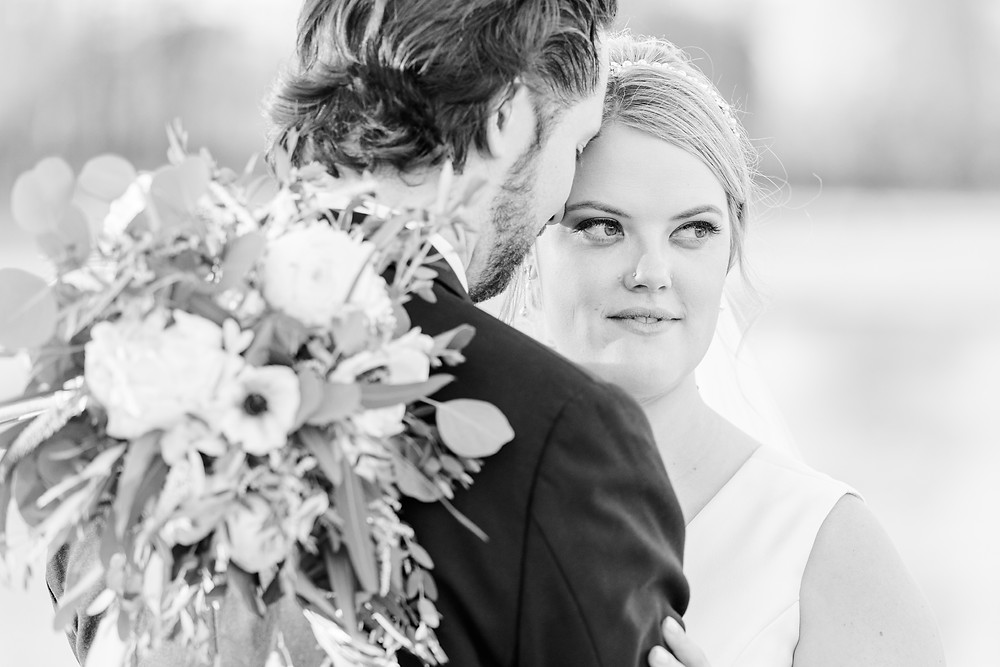 Josh and Andrea wedding photography husband and wife photographer team michigan Black Barn Wedding Venue rives junction spring bride and groom