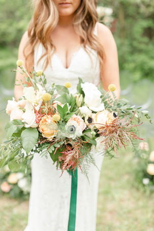 bouquet bride and groom ceremony in the details byron center truer design