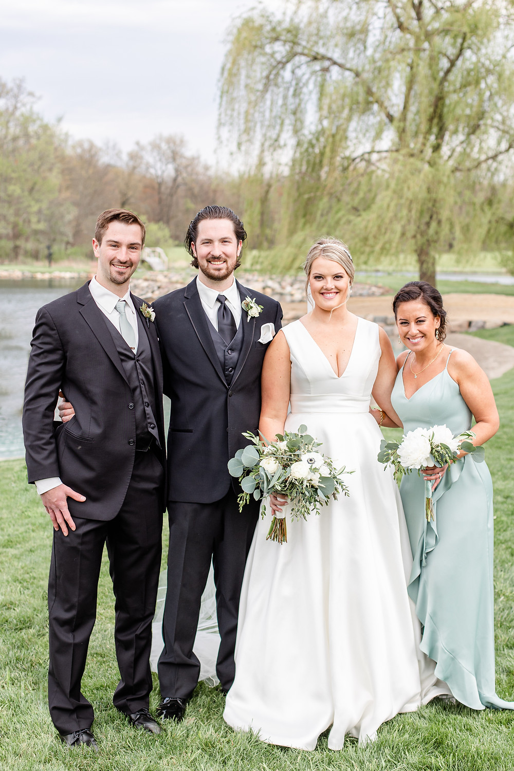 Josh and Andrea wedding photography husband and wife photographer team michigan Black Barn Wedding Venue rives junction spring bride and groom bridal party