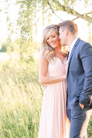 South Haven Michigan Cute Couple Engagement Photo Session standing smiling in field