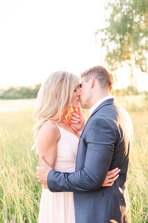 South Haven Michigan Cute Couple Engagement Photo Session kissing in a field