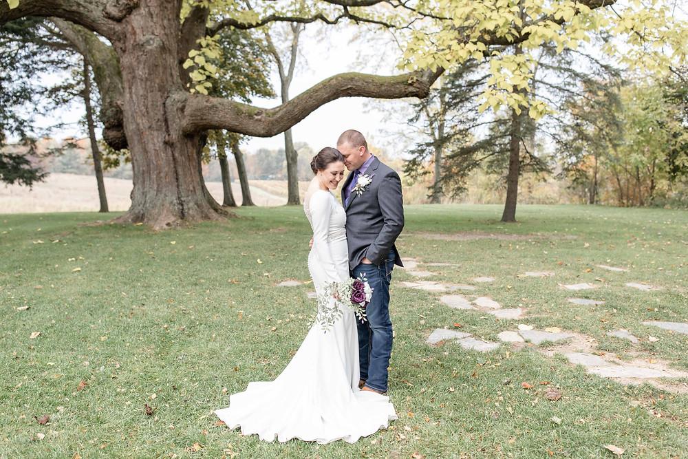 bride and groom hidden vineyard wedding barn Justin Alexander tree