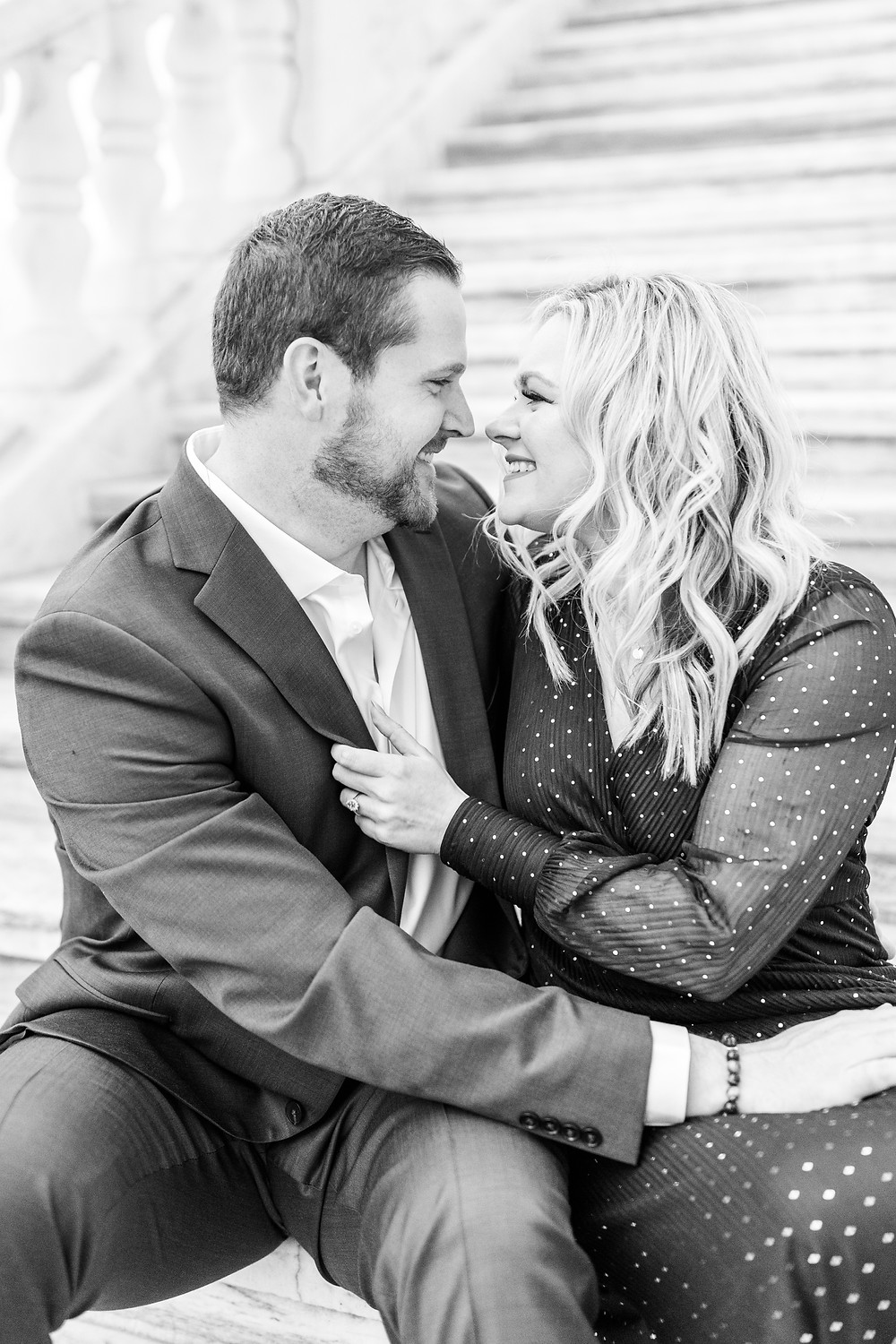 Josh and Andrea wedding photography husband and wife photographer team michigan engagement session photo shoot fiance detroit sitting smiling downtown