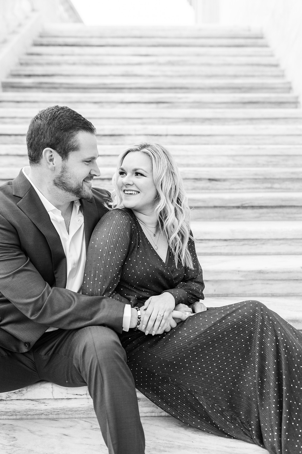 Josh and Andrea wedding photography husband and wife photographer team michigan engagement session photo shoot fiance detroit sitting smiling