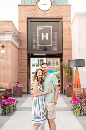 engaged couple standing at the H downtown Midland Michigan