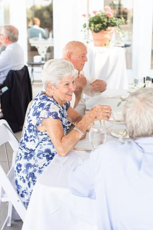 grandma smiling at table reception Kent Country Club Wedding Grand Rapids