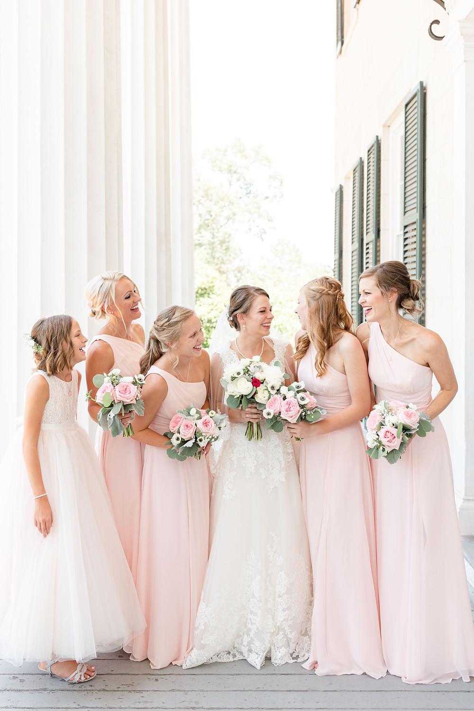 Bride and Bridesmaids walking and laughing Rose Hill Antebellum Lockerly Arboretum Milledgeville Georgia Wedding