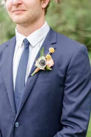 boutonniere groom ceremony in the details byron center truer design