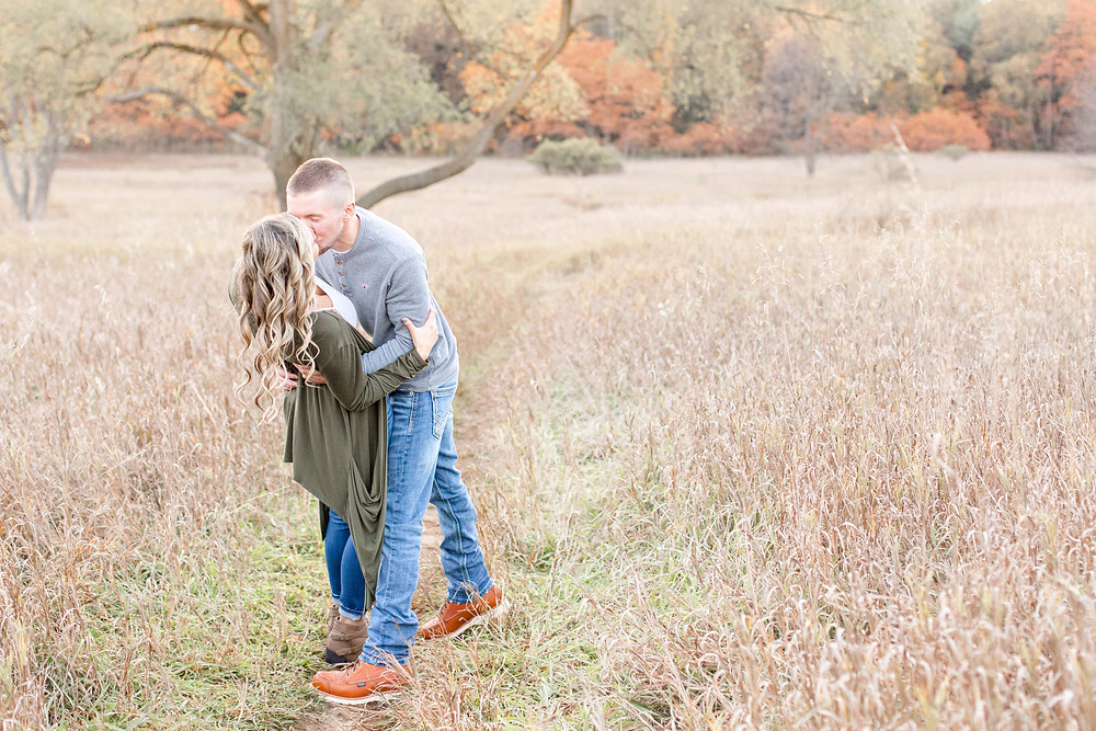 Josh and Andrea Photography engagement shoot Al Sabo cute couple kissing in field