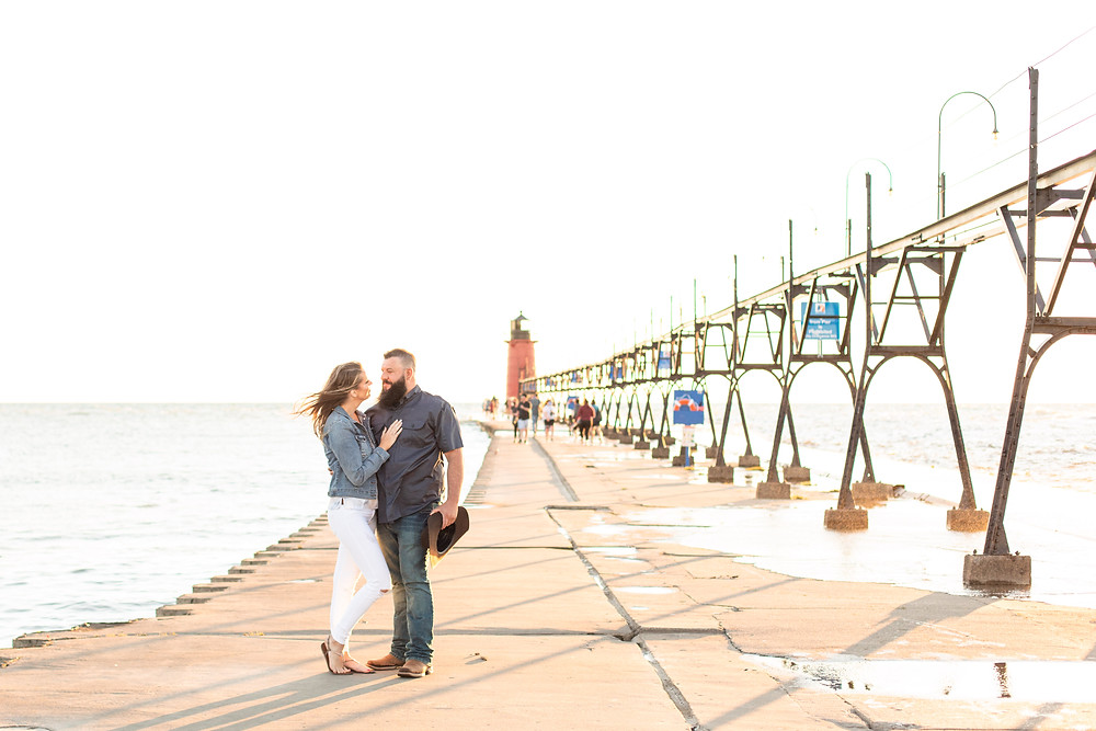 Engagement Photos Engaged Couple South Haven Beach Lighthouse Pier Michigan Engaged Couple standing