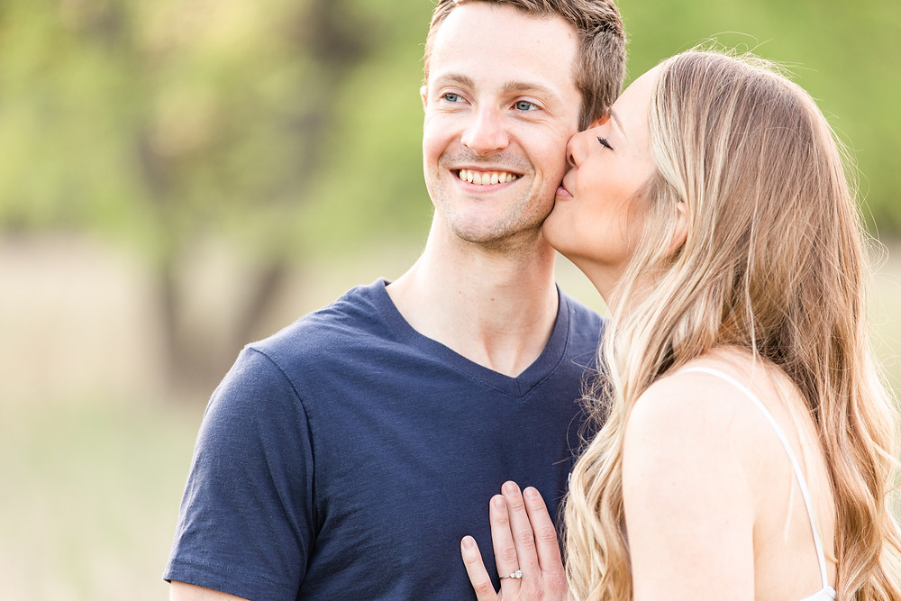 Josh and Andrea wedding photography husband and wife photographer team michigan Al Sabo Land Preserve engagement pictures session photo shoot fiance woods field kissing