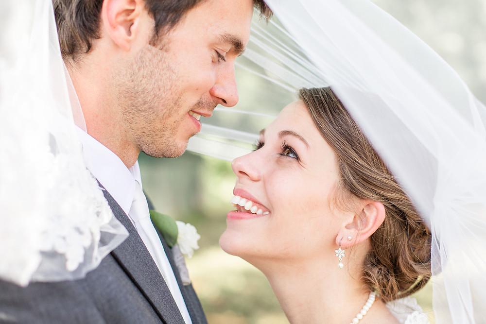 Bride and Groom smiling under veil Wedding Milledgeville Georgia